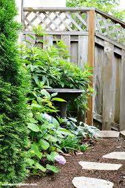 Tiered Backyard Landscaping Ideas Broken Fountain Turned Tiered Planter At The Picket Fence