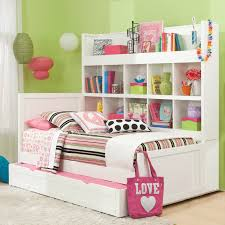 white twin daybed with trundle and tall open shelving unit