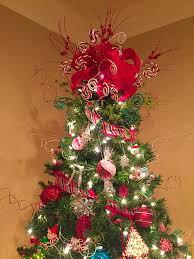 my tree topper made from hobby lobby ribbon and picks christmas