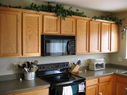 Top Of Kitchen Cabinet Decorating Ideas Simple Above Kitchen Cabinet Decorations Upon Home Decor