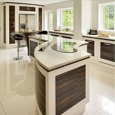 White Modern Kitchen Designs - the unique curved kitchen island provides extra casual seating in
