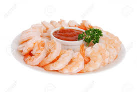 martini shrimp a plate of shrimp prawns with cocktail sauce on a whte background