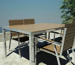 designer garden table in teak and stainless steel with grout