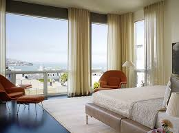 minimalist ripple fold drapes set the tone in this master bedroom