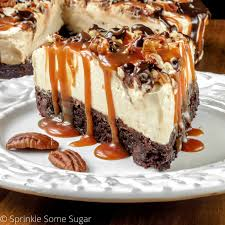 bake caramel turtle cheesecake sprinkle some sugar