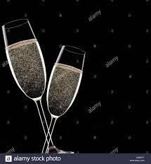 chagne flutes on black background celebration theme stock