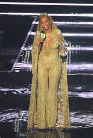 white and gold jumpsuit beyonce wears elie saab fall 2015 couture gold embroidered