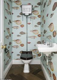 the smallest room can be stylish fornasetti wallpaper fishbowl