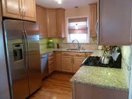 giallo ornamental granite countertops with maple cabinets