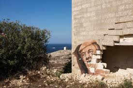 malta s walls are covered in murals and street art is covered in graffiti depicting donald j trump is seen here on the wall of an abandoned building of the white rocks complex in pembroke malta