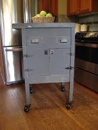 rustic gray mobile kitchen island with metal hinge and wheels of