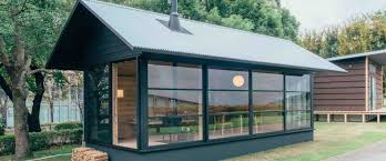 Pop Up Tiny House by Muji Unveils Trio Of Tiny Prefab Homes That Can Pop Up Almost