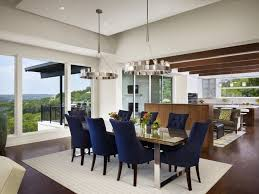modern luxury dining room interior design with navy blue chairs