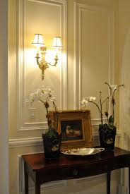 beautiful setting featuring classic wall panels and cast brass