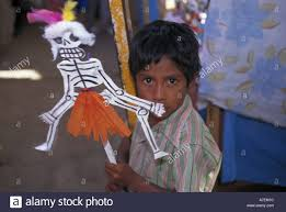 halloween in mexico mexico oaxaca boy selling day of the dead puppet in the muertos