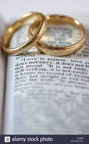 1 corinthians 13 wedding two gold wedding rings lie on an open bible the verses are from 1