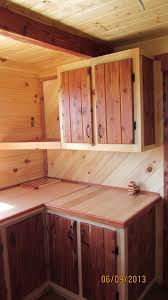 trophy amish cabins llc interiors optional matching butcher block cutting board lazy susan and pen holder