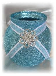 light blue glitter with white ribbon and brooch votive candle