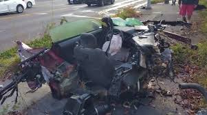 Black Mustang Crash Ford Mustang Hits Light Pole Ripping The Car In 2 Driver