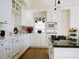 calming small kitchen design with l shape white kitchen cabinet