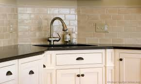 white kitchen sink faucet white cabinets tan countertops white