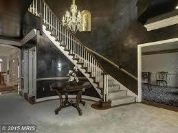 traditional staircase with interior wallpaper u0026 high ceiling in