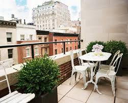 astonishing balcony furniture set on rooftop with white chairs and