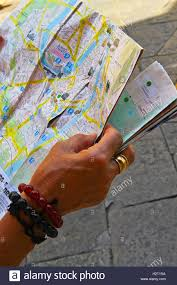 Map Of Verona Italy by Woman U0027s Hand With Bracelets Gold Ring Reading City Map Of Verona