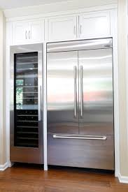 kitchen room refrigerator wood panels undercounter freezer