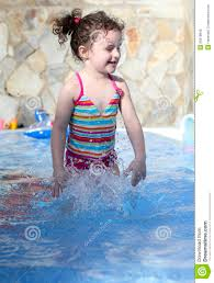 Cute Small Girl Is Playing In The Swimming Pool Stock Image  Image
