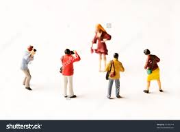 miniature figurines photographers model on white stock photo