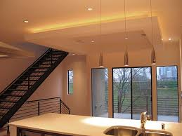 cool track lighting installation above the kitchen island ambient lighting created at ceiling above the bulkhead potlights
