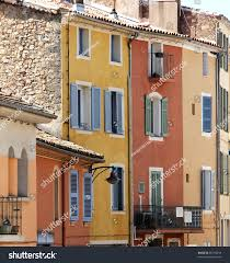 nice mediterranean house facades different colours stock photo