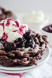 chocolate funnel cake with cherry compote and whipped cream black