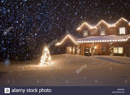 christmas lights that look like snow falling log home decorated with christmas lights with snow falling overhead