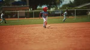 Home Plate Baseball by Cute Kid Running And Sliding On Home Plate During Baseball Game