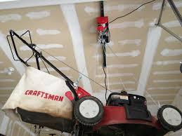 Garage Ceiling Storage Systems by Lawnmower Garage Ceiling Storage Storage Solutions Pinterest