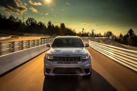 jeep trackhawk back the 707 hp jeep grand cherokee trackhawk is a racecar in disguise