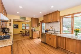 yellow kitchen wood cabinets 75 beautiful yellow kitchen with brown cabinets pictures