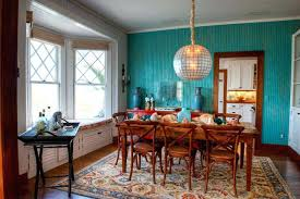 tropical dining room turquoise accent wall beach cottage tropical dining room turquoise