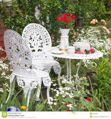 Garden Furniture Set Garden Furniture Set With Flowers Growing In Garden Royalty Free