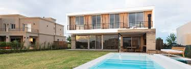 arquitectura overlaps simple volumes to create pool house in argentina
