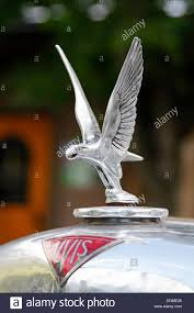 a mascot of an classic alvis silver eagle car stock photo