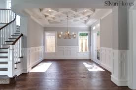 traditional dining room with detailed ceiling and wainscoting