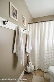 bathroom towel hooks ideas how to install an easy diy beadboard hook wall in a bathroom it s