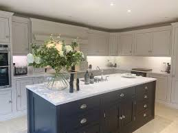 two tone kitchen cabinets with black countertops 21 two tone kitchen cabinets that are on trend in 2021