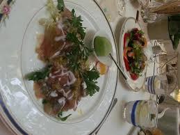 comi de cuisine maravilhoso prato que comi à base de salada e presunto de parma