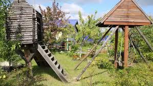Summer House For Small Garden - garden house on a rain day downpour on small wooden garden house
