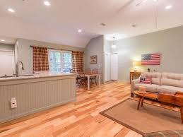open floor plan living room simulated wood floors high ceilings