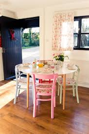 my freshly painted dining table with different coloured chairs u0026 a